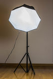 Photostudio equipment: switched-on softbox. On parquet and white backround Royalty Free Stock Image
