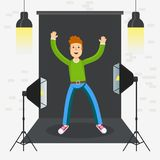 Photostudio guy happy. Boy in photo studio. Equipment for photo studio, production of films and advertising. Flat vector cartoon illustration. Objects isolated Stock Images