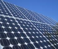 Photovoltaic cells solar panels blue sky. Solar panel photovoltaic cells array close up with blue sky copy space. Solar energy is an ecofriendly power source stock photo