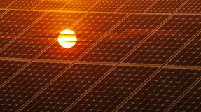 Photovoltaic energy. Renewable energy concept with photovoltaic panel and red sun Stock Photos