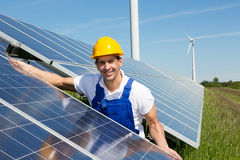 Photovoltaic engineer or installer installing solar panel Royalty Free Stock Image