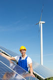 Photovoltaic engineer or installer installing solar panel Royalty Free Stock Images