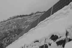Photovoltaic enheter som täckas med snö Arkivfoton