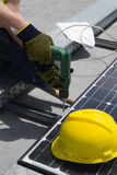 Photovoltaic laborer. At work in a plant Stock Images