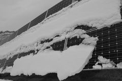 Photovoltaic moduły zakrywający z śniegiem Obraz Stock