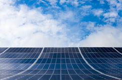 Photovoltaic modules of solar panels with sky on background Royalty Free Stock Photos