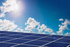 photovoltaic panel and sun shining Royalty Free Stock Image