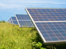 Photovoltaic panels in a green meadow. Stock Images