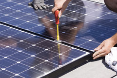 Photovoltaic panels laborer Stock Photo