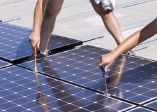 Photovoltaic panels laborer stock photography