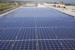 Photovoltaic panels laborer Royalty Free Stock Photo
