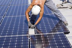 Photovoltaic panels laborer Royalty Free Stock Image