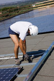 Photovoltaic panels laborer Royalty Free Stock Photography