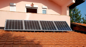 Photovoltaic panels mounted on a roof. Royalty Free Stock Images