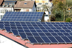 Photovoltaic panels on roof Stock Images
