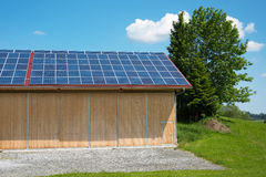 Photovoltaic panels on roof of barn Stock Photography
