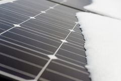 Photovoltaic panels on the roof cover with snow, in the winter Stock Photo