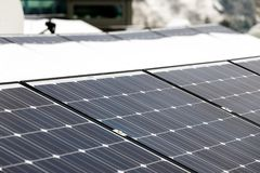 Photovoltaic panels on the roof cover with snow, in the winter Royalty Free Stock Photos