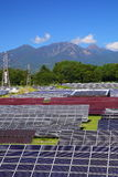 Photovoltaic power plant and mountain Stock Images