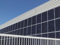 Solar energy panels at modern building wall. Photovoltaic solar energy panels, alternative electricity source, cheap and clean energy Stock Photos