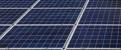 Solar energy panels selective focus. Photovoltaic solar energy panels, alternative electricity source, cheap and clean energy Royalty Free Stock Photo