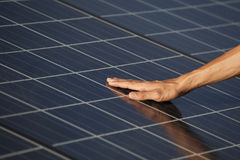 Photovoltaic solar focusing on worker's hand Stock Photography