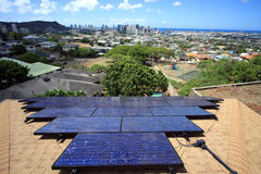 Photovoltaic solar on house. A set of photovoltaic solar modules with scenic view of Honolulu, Hawaii Royalty Free Stock Photos