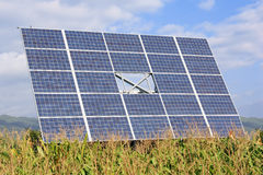 Photovoltaic solar panel. Big photovoltaic solar panel in green field Stock Photos