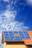 Photovoltaic solar panel on cloudy sky Stock Images