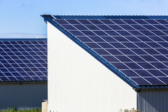 Photovoltaic Solar Panels on agricultural warehouses Royalty Free Stock Photos