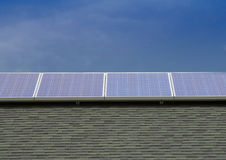 Photovoltaic Solar Panels Mounted on Roof Royalty Free Stock Photography