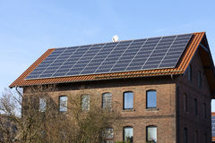 Photovoltaic solar panels on the roof. Alternative energy photovoltaic solar panels on the roof of a residential building Stock Photos