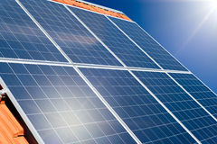 Photovoltaic solar panels on a tile roof Royalty Free Stock Images