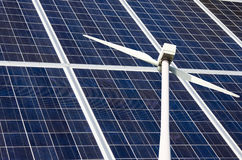 Photovoltaic Solar Panels and Windmill Turbine Stock Photo