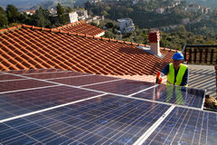 Photovoltaic worker Stock Photo