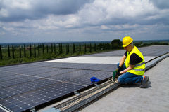 Photovoltaic worker. Photovoltaic worke in a roof working to fix it Royalty Free Stock Photo