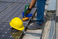 Photovoltaic worker. Photovoltaic worke working in a roof Stock Images