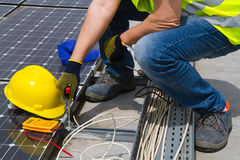 Photovoltaic worker. Photovoltaic worke working in a roof Royalty Free Stock Photos
