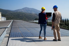 Photovoltaic workers royalty free stock images