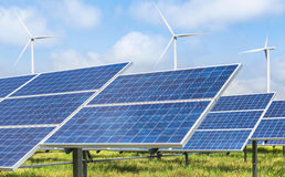 Photovoltaics模块太阳电池板和发电的风轮机 免版税图库摄影