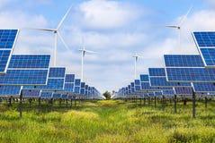 Photovoltaics模块太阳电池板和发电的风轮机 免版税库存图片