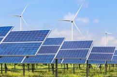 Photovoltaics模块太阳电池板和发电的风轮机 库存照片