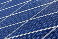 Photovoltaics. Crystalline silicon modules on a housetop Royalty Free Stock Image