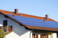 Photovoltaics. Photovoltaic - Electricity generation with solar panels on the roof Stock Photo