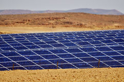 Photovoltaics in desert solar power farm in the Negev desert, Is. NEGEV DESERT, ISR - APR 14 2015:Photovoltaics in desert solar power farm in the Negev desert Stock Image