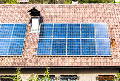 Photovoltaics panel on the old roof.  Stock Photo