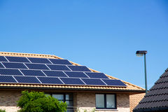 Photovoltaics on the roof of a residential building for alternative energy production. Photovoltaics on the roof of a residential building for alternative Stock Images