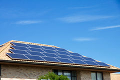 Photovoltaics on the roof of a residential building for alternative energy production. Photovoltaics on the roof of a residential building for alternative Royalty Free Stock Image