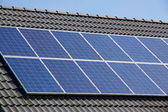 Photovoltaics on the roof of a residential building for alternative energy production. Photovoltaics on the roof of a residential building for alternative Stock Image