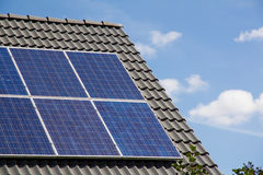 Photovoltaics on the roof of a residential building for alternative energy production. Photovoltaics on the roof of a residential building for alternative Stock Photos
